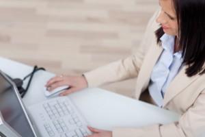 Businesswoman working at a desktop computer